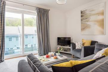 The sitting-room overlooks the parking area and neighbouring apartments.