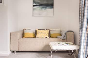 The corner sofa in the sitting-room is a perfect spot to read the morning paper.