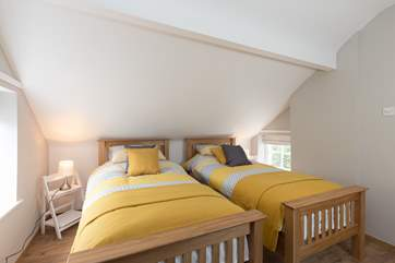 Another view of the dual-aspect twin bedroom.