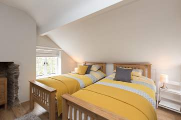 This is the pretty twin bedroom. The sloping ceiling is a real feature of this age of property but do take care of your heads.