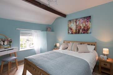 This is the double bedroom, peaceful and calm and with its outlook to the front of the cottage.