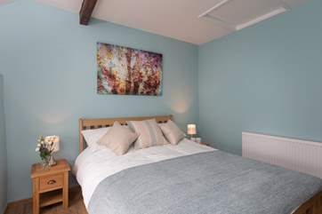 As with the master bedroom the high ceiling creates a feeling of space and light.