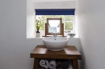 There is a stylish bespoke basin surround.