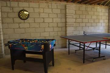 There is a games room in the garage. Access is through the garden. This is separate to the outbuilding which offers safe bike storage.