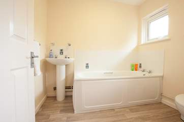 The downstairs bathroom is ideal for a quick rinse after returning from the beach