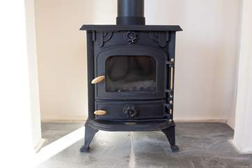 The log burner is a welcome addition in the colder months