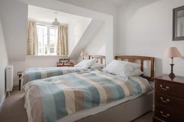 The third bedroom has twin beds.