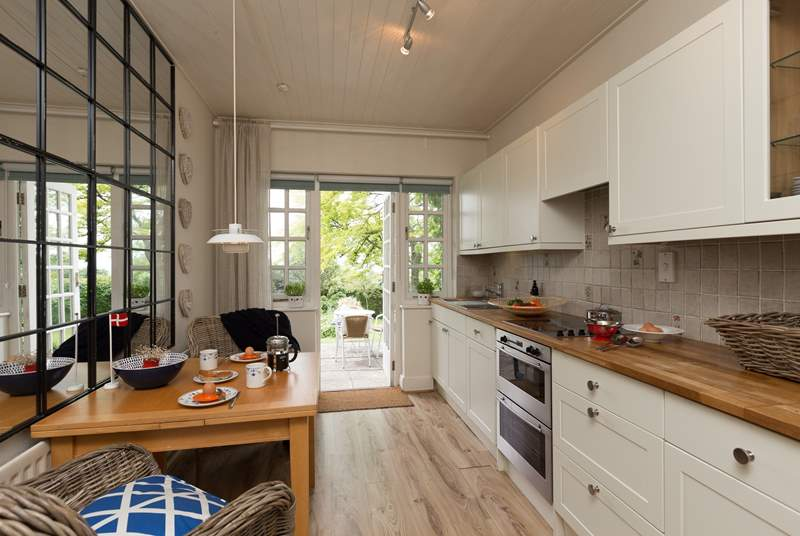 The kitchen is bright and has a wonderful contemporary feel, with a door directly out to the terrace above the gardens.