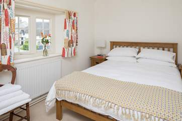 This pretty bedroom has a 5ft bed and looks out over the square.
