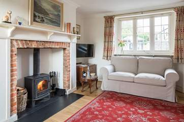 The sitting-room has a cosy wood-burner for chilly evenings.