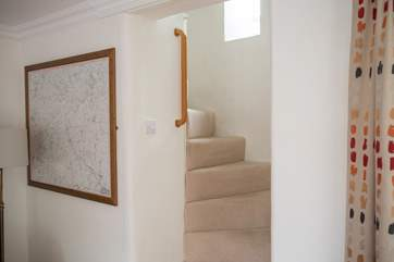 The turning cottage stairs are a delightful feature in this listed cottage, there are grab rails all the way up.