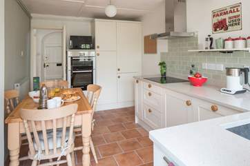 The bespoke kitchen/dining-room has all brand new appliances including an induction hob.