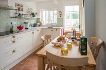 The stylish kitchen/dining-room leads out into the conservatory.