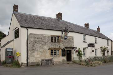 The Fox and Hounds is across the square, an award winning pub serving great food and real ales.