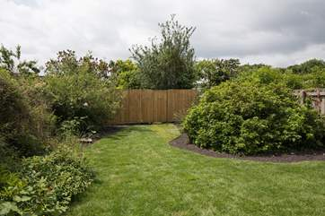 The garden is fully enclosed to keep little ones and dogs safe,
