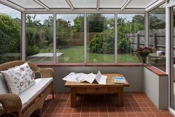 The conservatory looks out over the enclosed south-west facing garden.