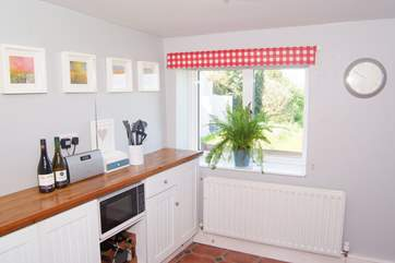 You can see the sea from the kitchen which  is at the back of the cottage with a door straight out onto the rear garden with its incredible views.