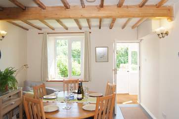 The dining room is bright and sunny, with a stable door so that you can bring the outside in