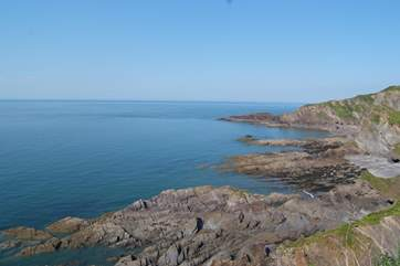 This is the nearby coastline between Ilfracombe and Berrynarbour. Lots of coves and rock pools to explore. There is a sandy bay at Combe Martin and a vast sandy beach at Woolacombe.