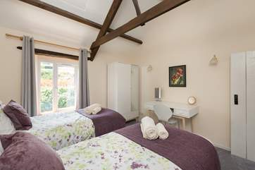 The twin bedroom has an outlook over the fields above the cottage on the other side of the road