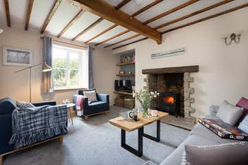 There is a lovely cosy sitting room with wood burner effect electric stove and character beams.