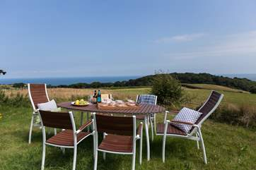 The lawned rear garden has open views across countryside to the sea.