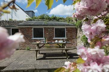 Right at the bottom of the garden is a sun terrace, with lovely views. The building behind is for storage only.