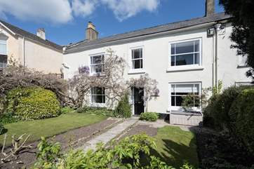 This elegant house is set back from the main street that runs through the village of Charmouth.