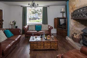 The elegant sitting-room has a cosy wood-burner for chilly evenings.