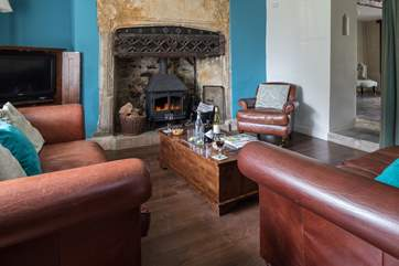 The sitting-room has this magnificent fireplace and wood-burner.