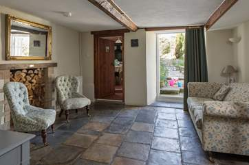 The snug with original stone flooring and French doors onto the patio area.