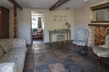 The snug leads from the dining-area into the sitting-room and the hallway.