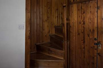 The spiral stairs that lead to bedrooms 2 and 4, which can be used as a suite. Both rooms can also be accessed via the main staircase.