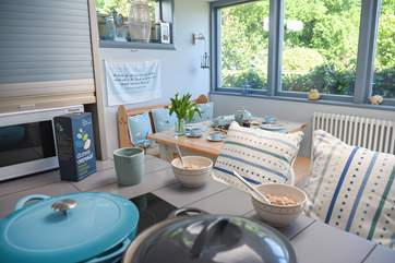 The open plan kitchen/dining-room has been beautifully deecorated