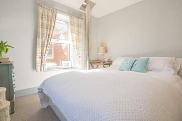 This bedroom is bright and airy with a cosy feel....