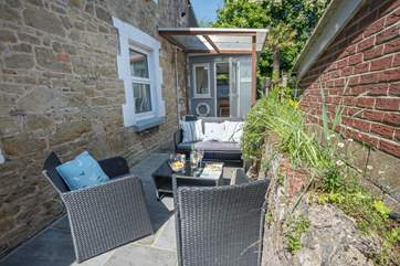The lovely patio area is a great place to sit outside and enjoy the sunshine