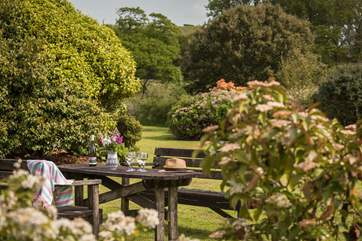 Enjoy a glass of wine and look out over the tranquil garden.