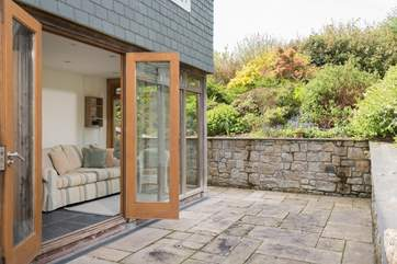 Double doors open from the conservatory.
