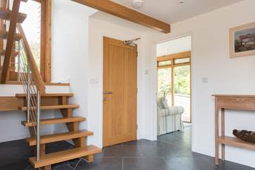 The entrance halll with WC and stairs to the Westwing Bedroom.