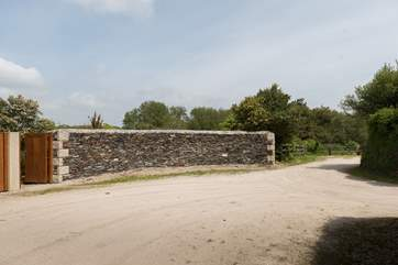 The gate leads into the courtyard at Chygowlin House, turn right at the end of the drive to the private parking.