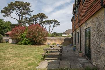 The enclosed garden of Hobnob, faces the south west and catches the sun all day.