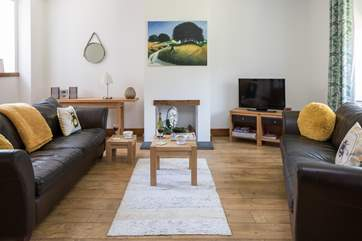 Time to relax, the spacious sitting-room has plenty of light.