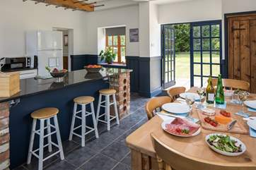 French doors lead from the kitchen/dining-room into the garden, the parking-area is outside and to the right.