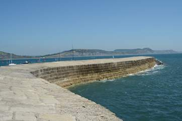 The iconic Cobb at Lyme Regis, with Golden Cap in the background.