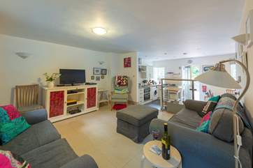 The ground floor is open plan, there are two steps down to the kitchen from the sitting-area.