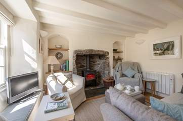 The sitting/dining-room with a roaring wood-burner.