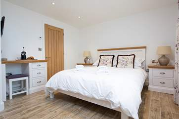 The double bedroom has a king-size bed and exquisite linens.
