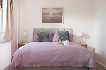 The master bedroom has lovely calm tones.