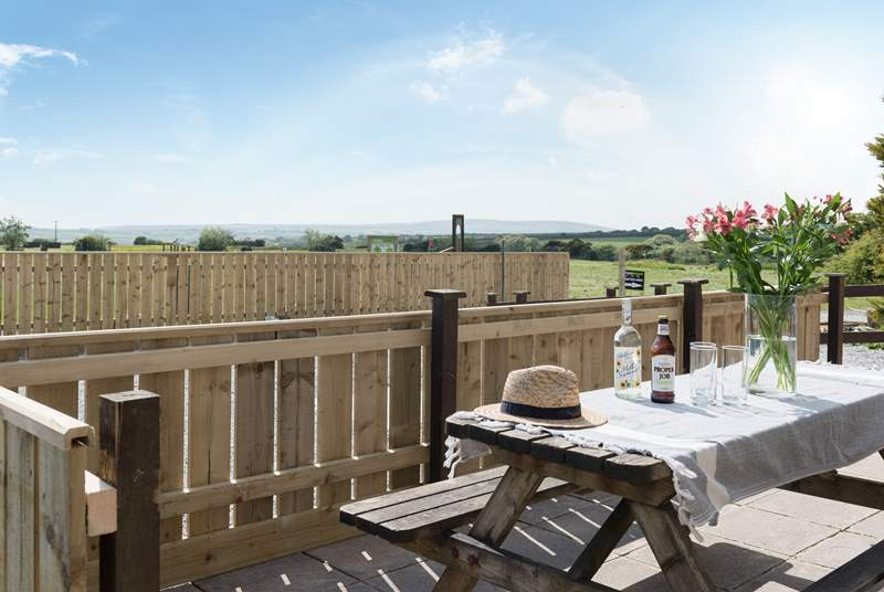 Enjoy a glass of wine on the front terrace overlooking Cornwall.