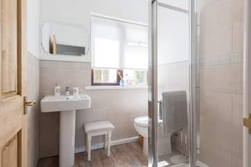 The family shower-room has a large walk-in shower.